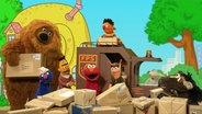"""Elmo, Ernie, Bert, Samson, Wolle, Pferd, Grobi und Finchen singen den """"Nachbarschaftssong"""". © NDR/Sesameworkshop Foto: Screenshot"""