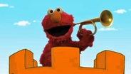 Elmo spielt im neuen Vorspann der Sesamstraße Trompete © NDR/Sesame Workshop