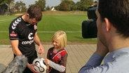 FC St. Pauli-Spieler Sebastian Schachten und  Kjell © NDR/Melanie Kuss Fotograf: Melanie Kuss